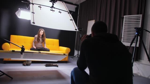 backstage of a fashion model studio photo shoot - photo shoot stock videos & royalty-free footage