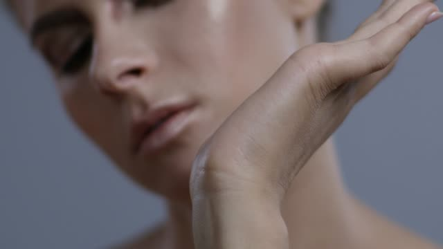 backstage of a make-up artist applying foundation on fashion model`s hand. fashion video. - greasepaint stock videos and b-roll footage