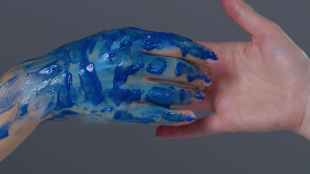backstage of a make-up artist, putting blue glowing paint on model`s hand. fashion video. - greasepaint stock videos and b-roll footage