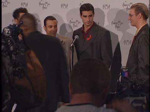 backstreet boys at the american music awards 1998 at shrine. - aids awareness ribbon stock videos & royalty-free footage