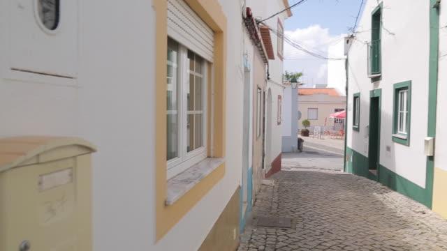 backstreet, ferragudo, algarve, portugal, europe - algarve stock videos & royalty-free footage