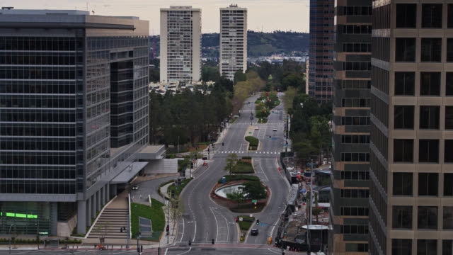 backward drone shot through quiet century city during covid-19 lockdown - beverly hills california stock videos & royalty-free footage