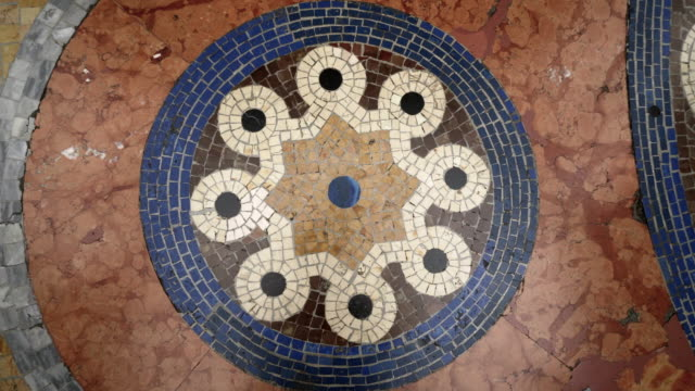 backward: flooring of building made of tiles with designed theme in a building in milan italy - abstract stock videos & royalty-free footage
