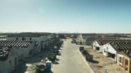 Backwards Drone Flight Along New Street with Half Built Houses