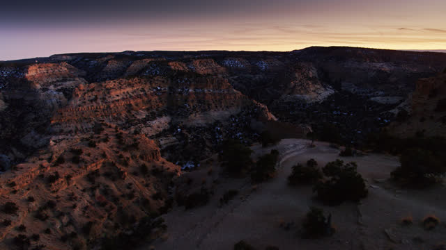 backwards drone flight out of devil's canyon at nightfall - southwest usa stock videos & royalty-free footage