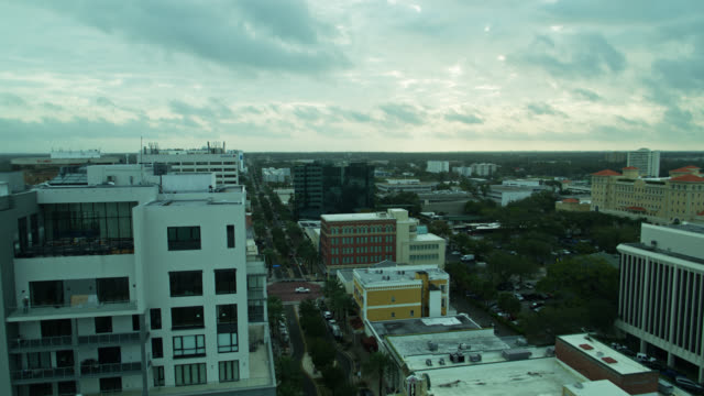 backwards drone flight over downtown clearwater, florida - gulf of mexico stock videos & royalty-free footage