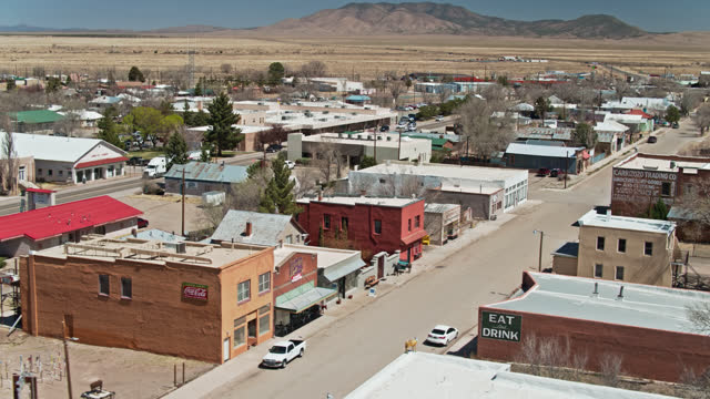 backwards drone flight over quiet streets in carrizozo, new mexico - lincoln town car stock videos & royalty-free footage
