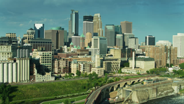 backwards drone flight over stone arch bridge looking at minneapolis skyline - former stock videos & royalty-free footage