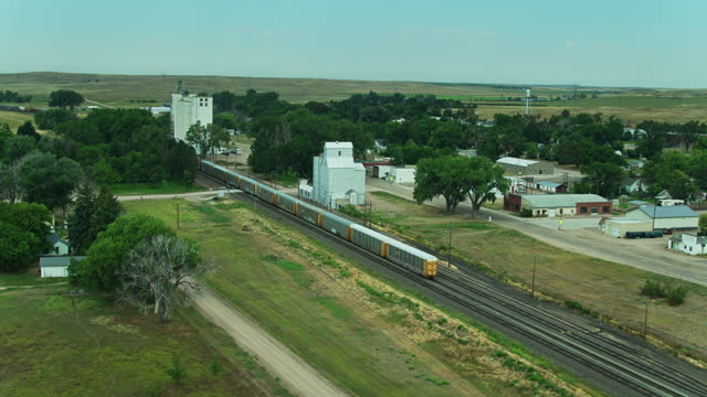 backwards drone flight past freight train in lodgepole, nebraska - freight elevator stock videos & royalty-free footage