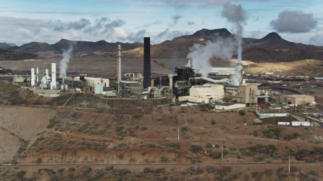 backwards drone shot of copper mining and smelting facility in miami, arizona - mining natural resources stock videos & royalty-free footage