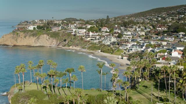 backwards drone shot of crescent bay on the orange county coast - laguna beach california stock videos & royalty-free footage