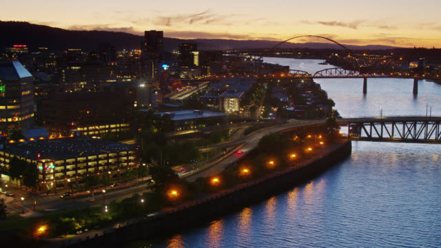 backwards drone shot of downtown portland at nightfall - portland oregon stock videos & royalty-free footage