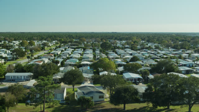 backwards drone shot of manufactured homes - florida us state stock videos & royalty-free footage