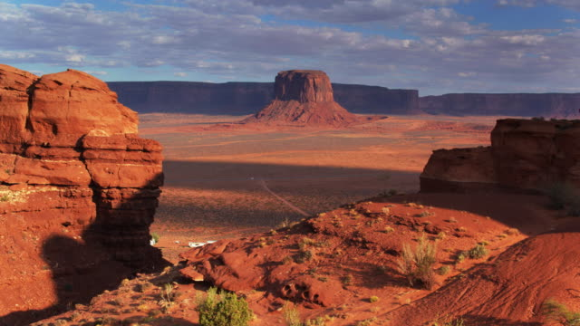 backwards drone shot of merrick butte, monument valley - navajo reservation stock videos and b-roll footage