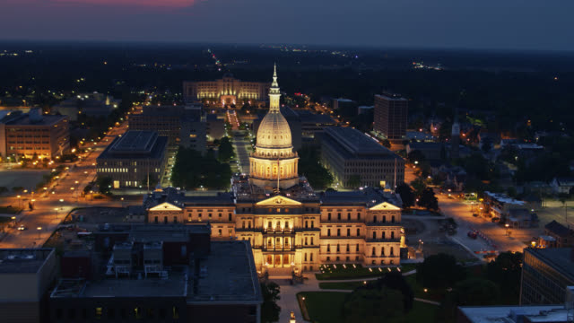 backwards drone shot of michigan state capitol and hall of justice past boji tower - lansing stock videos & royalty-free footage