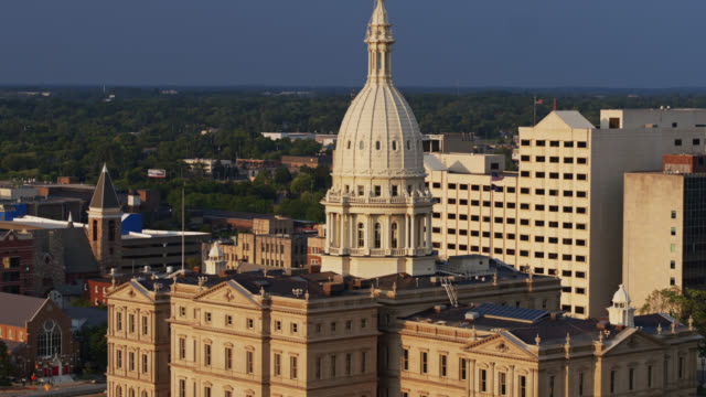 backwards drone shot of michigan state capitol - lansing stock videos & royalty-free footage