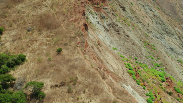 backwards drone shot of woman hiking near two harbors, catalina island - channel islands california stock videos & royalty-free footage