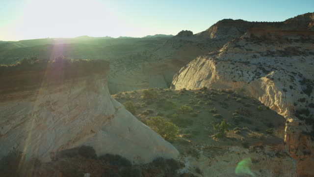 backwards drone shot over eagle canyon, utah at sunset - san rafael swell stock videos and b-roll footage