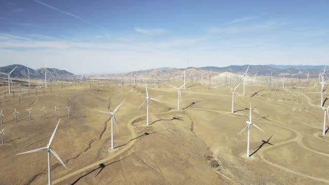 backwards drone shot over mojave wind farm - turbine stock videos & royalty-free footage