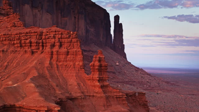 backwards drone shot past rock hoodoos in monument valley - navajo reservation stock videos and b-roll footage