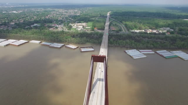 backwords over bridge reveal tops - Drone Aerial 4K Mississippi river bridge and barge 1of14, everglades, gulf delta, new orleans, st louis, with cruise boats sailing and wildlife 4K Transportation