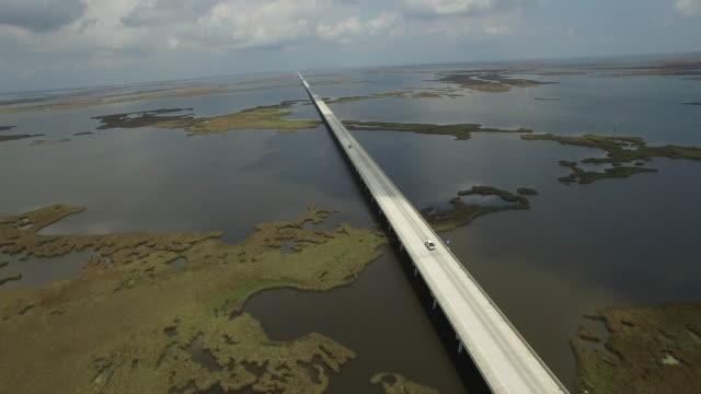 Backwords tracking over causeway endless - Drone Aerial 4K Lake Pontchartrain CausewayGrand Isle Louisiana coast Mississippi river bridge and barge everglades, gulf delta, with wildlife 4K Transportation
