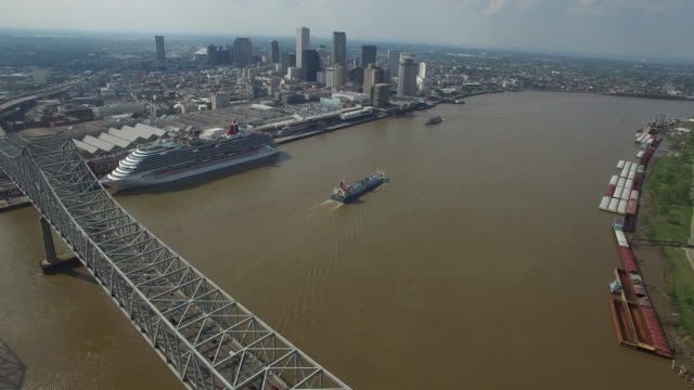 Backworks over bridge LONG reveal new orleans with barge - Drone Aerial 4K Mississippi river bridge and barge 1of14, everglades, gulf delta, new orleans, st louis, with cruise boats sailing and wildlife 4K Transportation