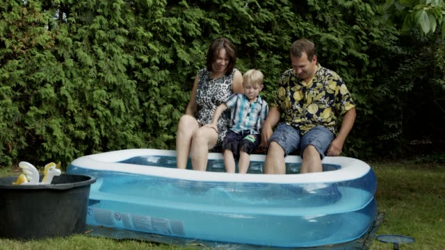 backyard hangout with family and kids - inflatable stock videos & royalty-free footage