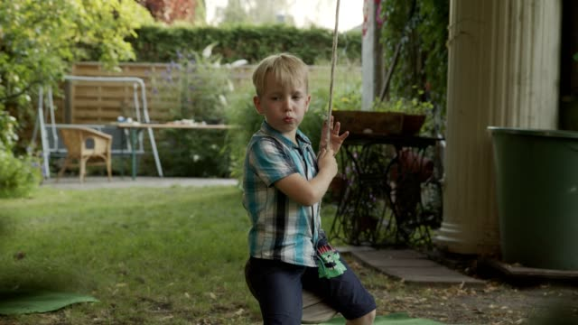 backyard hangout with family and kids - kauen stock-videos und b-roll-filmmaterial