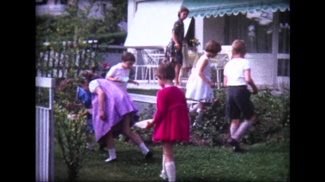 1963 backyard treasure hunt at birthday party - caucasian appearance stock videos & royalty-free footage
