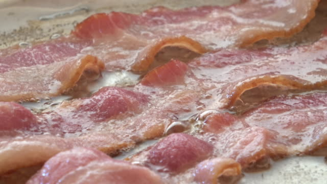 bacon frying in pan - bacon stock videos & royalty-free footage