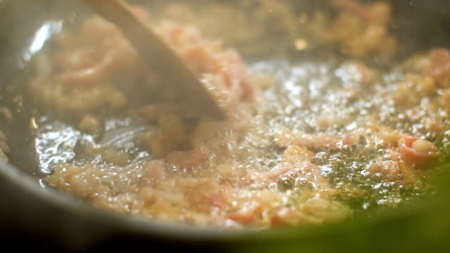 Bacon on frying pan, slo mo