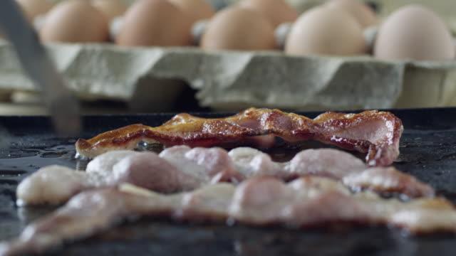 cu bacon rashers on frying pan / orem, utah, usa - bacon stock videos and b-roll footage
