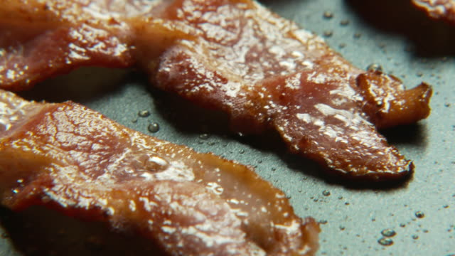 ecu, tu, bacon strips sizzling on frying pan, atlanta, georgia, usa - bacon stock videos & royalty-free footage