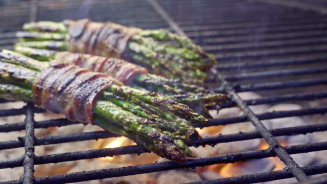 bacon wrapped asparagus on a fiery grill, ketogenic food - low carb diet stock videos & royalty-free footage
