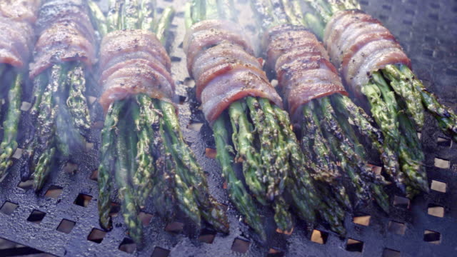 bacon wrapped asparagus on a fiery grill, ketogenic food - bacon stock videos & royalty-free footage