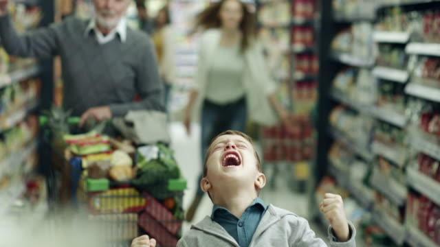 bad boy in supermarket - messing about stock videos & royalty-free footage