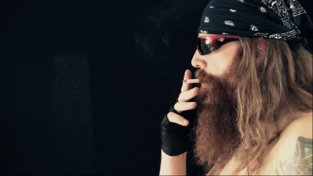 bad boy smoking profile - motorcycle biker stock videos & royalty-free footage