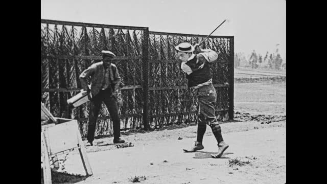 1920 bad golfer (buster keaton) keeps missing the ball - golfer stock videos & royalty-free footage