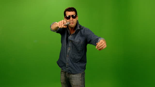 bad guy holding a gun - villain stock videos & royalty-free footage