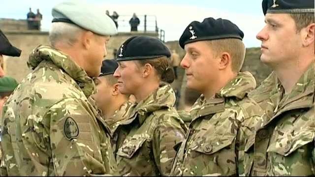 'bad lads army' contestant returns from afghanistan; ext morris talking with senior officer at medal ceremony and soldiers in front of castle - spielkandidat stock-videos und b-roll-filmmaterial