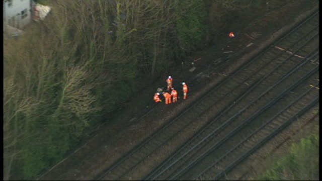 bad weather and rail failures cause travel disruption ahead of christmas east sussex brighton group of engineers working next to railway tracks - railway signal stock videos & royalty-free footage