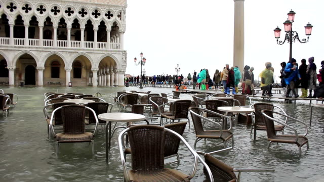 bad weather in venice - outdoor cafe flooding - venice italy stock videos and b-roll footage
