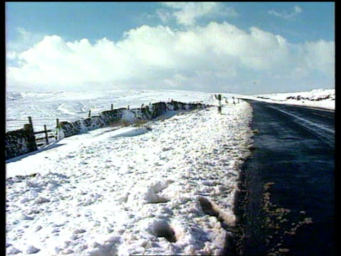 bad weather roundup northern ms empty roads across the pennines gv snowcovered landscape in lake district - pennines stock videos & royalty-free footage