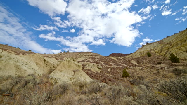 badlands yellow clay john day fossil beds formations clouds and shadows drift over a remote desert mountain sutton mountain close to the painted hills 10 - oregon us state stock videos & royalty-free footage