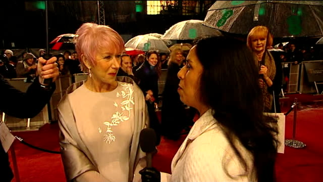 red carpet and interviews; people on red carpet / helen mirren on red carpet helen mirren interview sot sally field interview sot rain falling in... - bafta mask stock videos & royalty-free footage