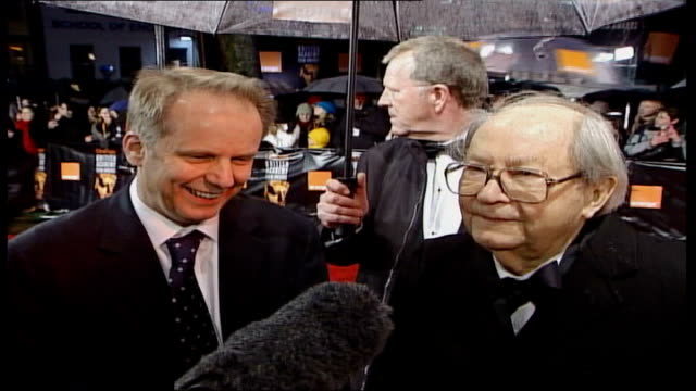 bafta awards ceremony; ext peter sallis speaking to press, standing alongside nick park sot - i won't walk away with it, he will, i'm too old to lift... - strapless stock videos & royalty-free footage
