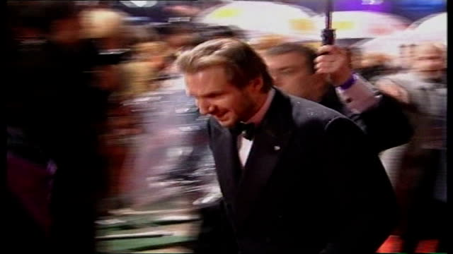 london leicester square pierce brosnan arriving for baftas ceremony holding umbrella ralph fiennes arriving jake gyllenhaal arriving side shot of... - george clooney stock videos and b-roll footage