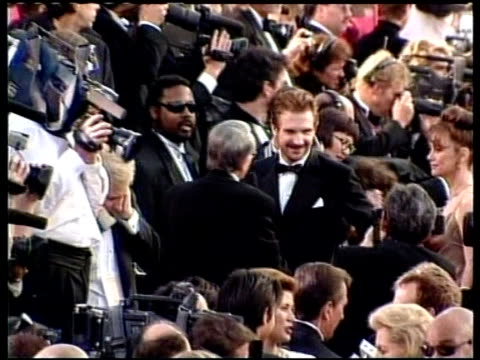 bafta awards; lib england: london: actor ralph fiennes, star of `the english patient', thru crowd at premiere tx 29.4.97/een - the english patient点の映像素材/bロール