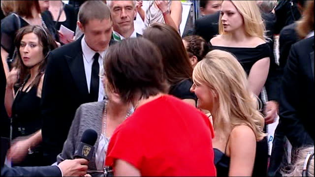 London EXT Piers Morgan signing autograph on red carpet Back view of Tim Burton on red carpet Julie Walters talking to Miranda Hart Julie Walters...